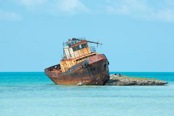 tugboat shipwreck on a rock near South Dock on Providenciales
