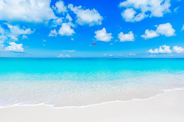 parasail and beautiful weather at Grace Bay Beach in the Turks and Caicos