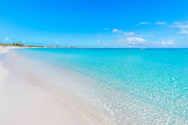 white sand and calm ocean at Grace Bay in the Turks and Caicos