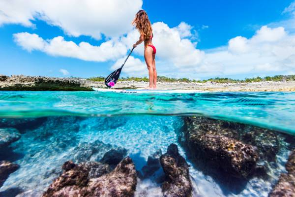 stand up paddle boarder on the coast of the Northwest Point Marine National Park