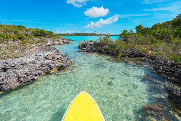 paddle board and rocky island in the Chalk Sound National Park in the Turks and Caicos