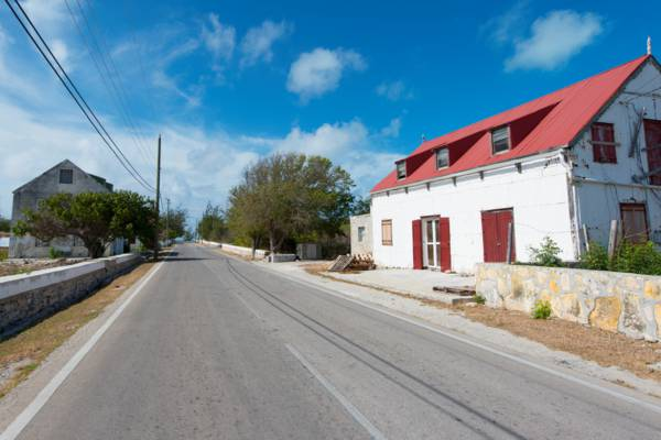 a street with homesteads on the island of South Caicos in the Turks and Caicos