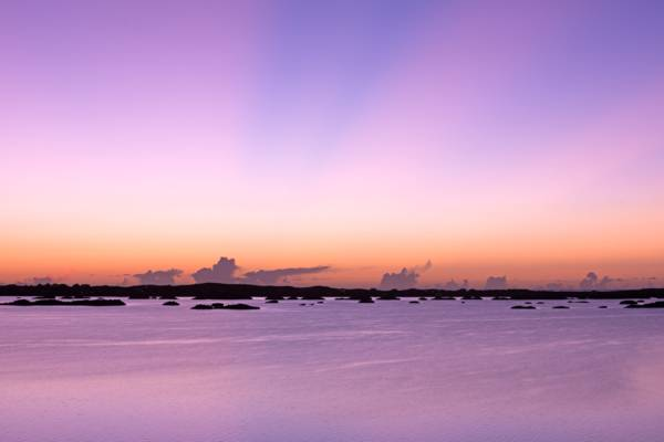 purple sunset over Chalk Sound National Park in the Turks and Caicos