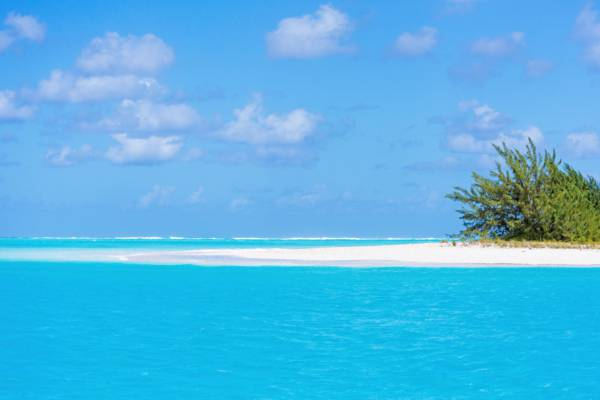 white sand beach and turquoise ocean at Dellis Cay in the Turks and Caicos