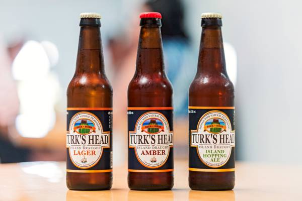 a bottle of Turk's Head lager, amber and IPA
