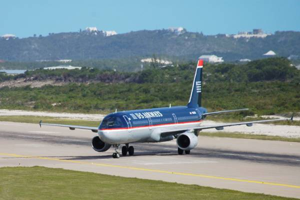 Boeing 757 airliner on the runway at the Providenciales International Airport