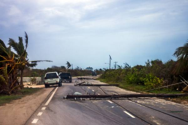 fallen utility poles at Blue Hills on Providenciales after Hurricane Hanna