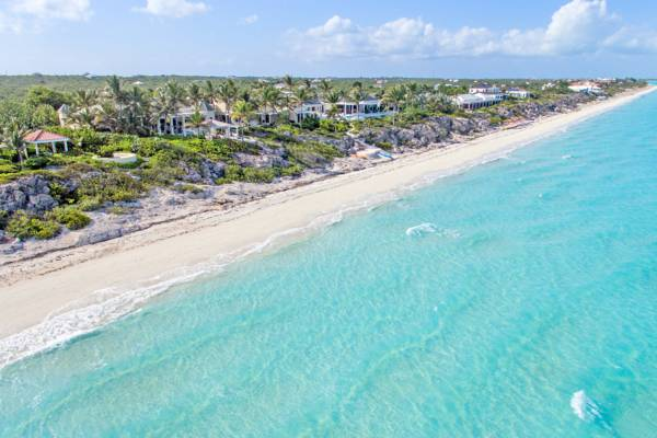 aerial view of long bay beach and luxury villas on providenciales