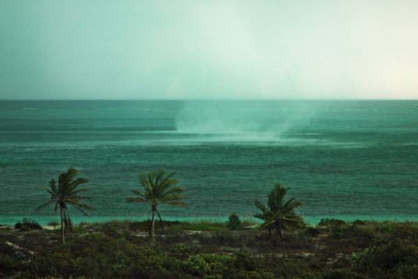waterspout forming during a storm at the Bight Beach on Providenciales