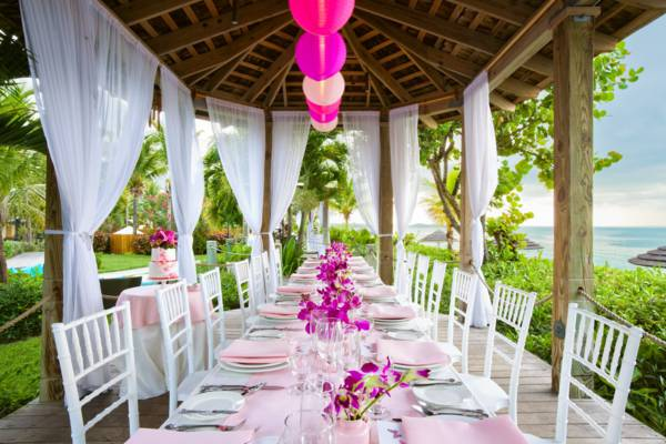 beachfront wedding dinner setting at Grace Bay