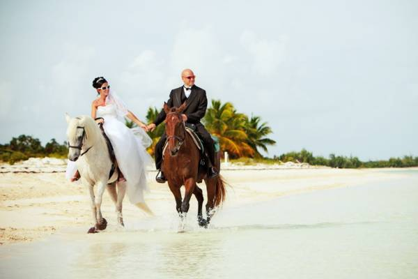 Turks and Caicos wedding photo shoot on horseback at Long Bay Beach