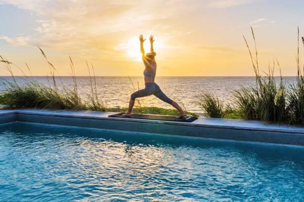 yoga session at the pool at Sailrock Resort