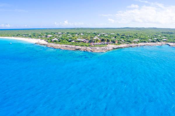 clear turquoise ocean water and the secluded Amanyara Resort on Malcolm's Road Beach