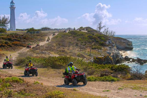 ATVs on the coastal path at the cliffs near the Grand Turk Lighthouse