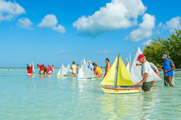 model sailboats and racers at Bambarra Beach during the Valentine's Day Cup Race