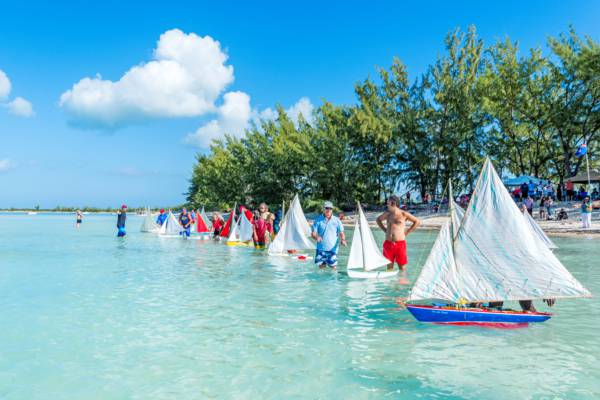 dozens of model Caicos Sloop sailboats at Bambarra Beach during the Valentine's Day Cup