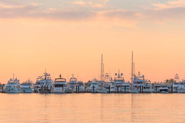 luxury yachts at Blue Haven Marina at dawn