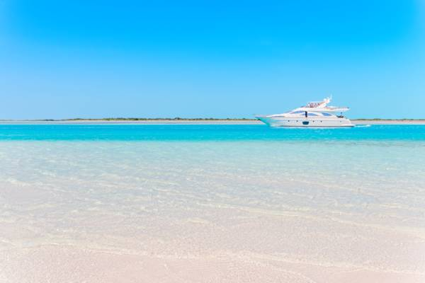 a luxury yacht in turquoise water in the Turks and Caicos