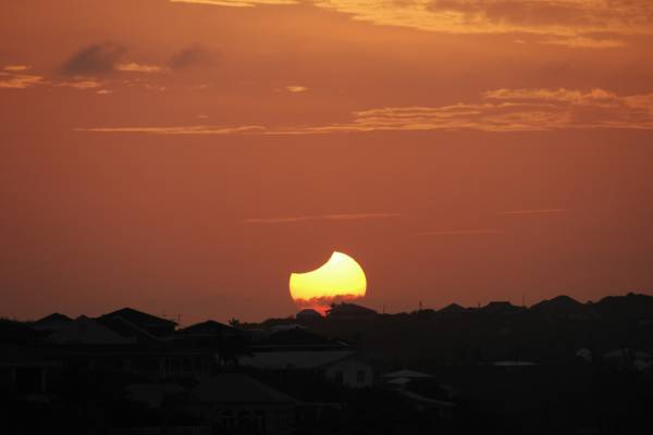 solar eclipse over Blue Mountain, Turks and Caicos