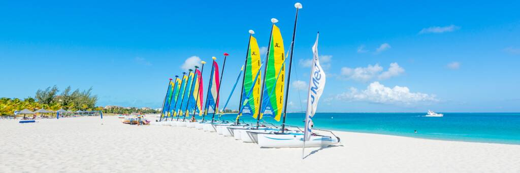 Hobie Cat sailboats on the wide white sand beach fronting Club Med