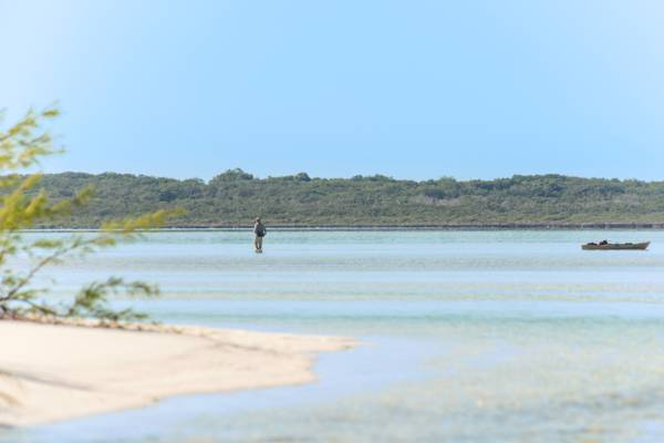 bonefishing in the shallow waters of Bottle Creek near Conch Cay