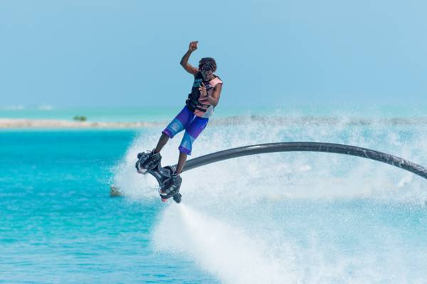 flyboarding in the turquoise ocean water off Providenciales