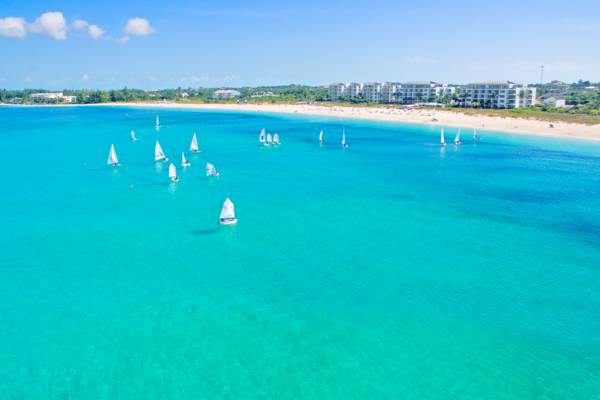 small sailboats in the turquoise ocean fronting Gansevoort resort