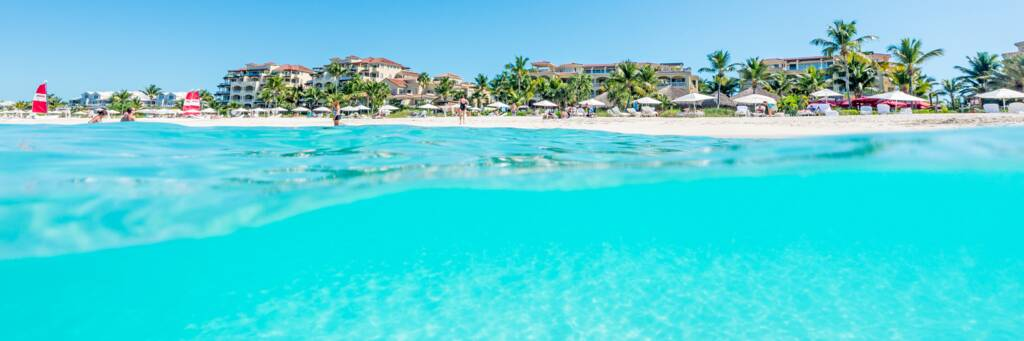 over-under photo of Grace Bay Club and turquoise ocean water
