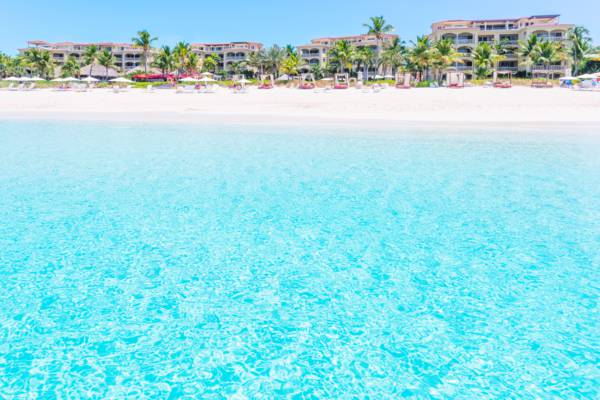 clear ocean water and white sand at the Grace Bay Club