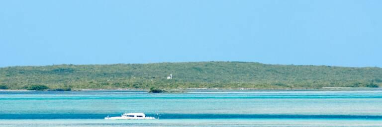 catamaran wreck and ruins on the horizon of Hog Cay