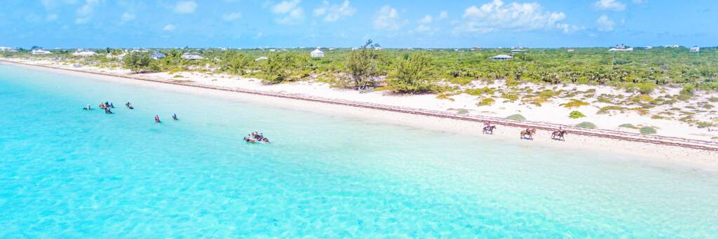 Horseback riding in the turquoise water at Long Bay Beach on Providenciales