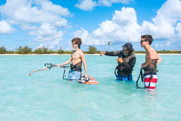 kiteboarding lessons in the shallow turquoise water at Long Bay Beach