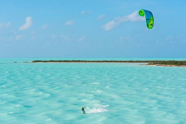 beautiful turquoise water and kiteboarder at West Harbour Bluff on Providenciales