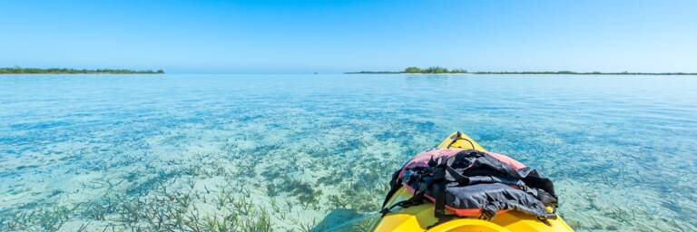 kayak on the calm and shallow waters of Bottle Creek lagoon near North Caicos