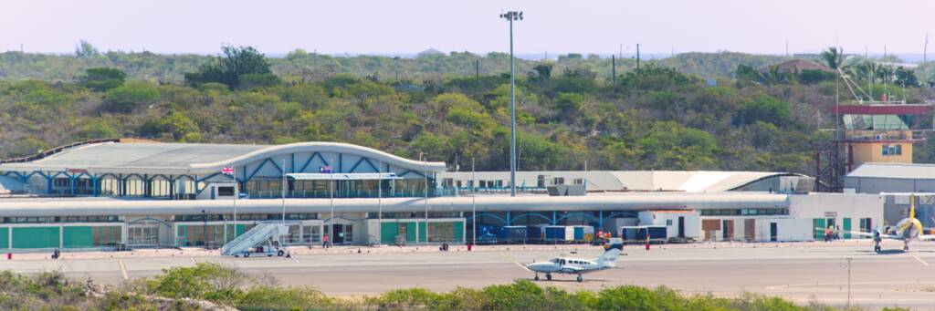 the main terminal and gates at the Providenciales International Airport