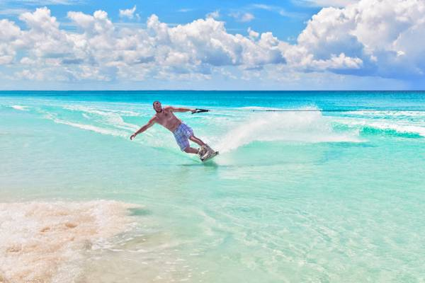 wakeboarding off a beautiful beach in the Turks and Caicos