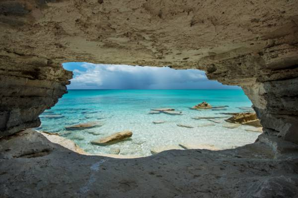 rock cave and arch on the coastline of Water Cay