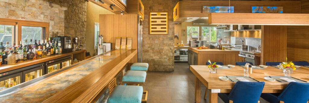 bar, dining room, and kitchen at WE Kitchen in Turks and Caicos