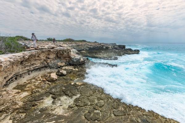 cliffs and surf in the West Caicos Marine National Park in the Turks and Caicos