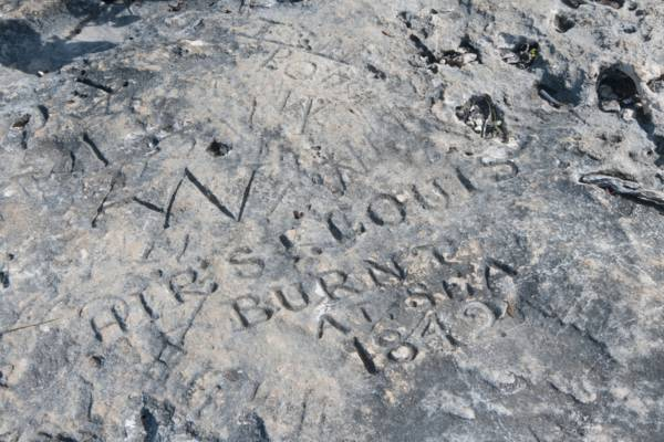 historical rock carving at West Harbour Bluff on Providenciales